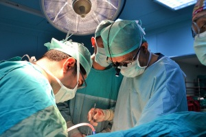 Dr. Levent Elbeyli (in loupes) in the operating room