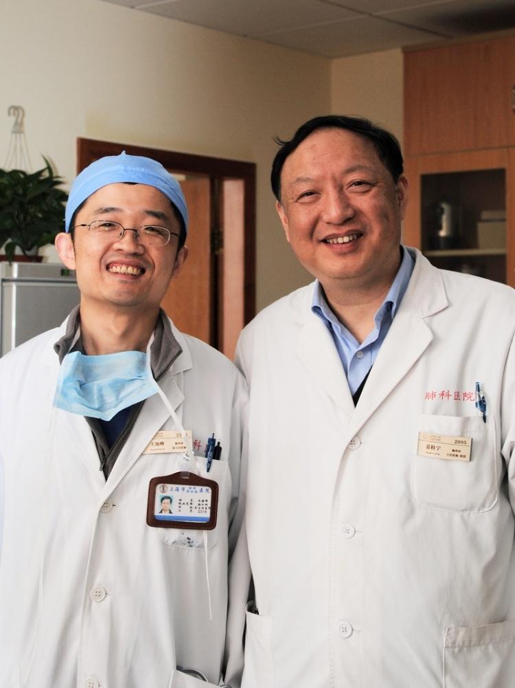 Dr. HaiFeng Wang with Dr. Jiang Gening (right)