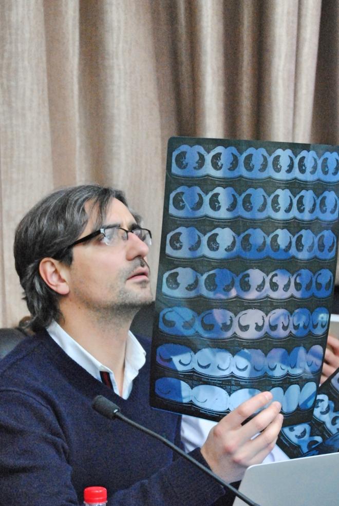 Dr. Gonzalez Rivas reviews patient films in consultation with local surgeons