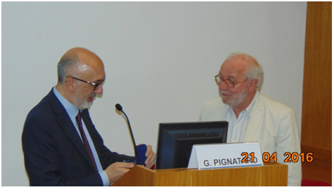Photo 2: The Rector of the University of Catania is giving the medal to Professor Tom Treasure